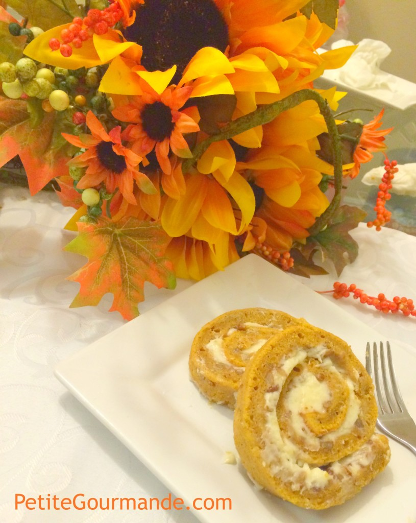 Pumpkin Roll cut into pinwheels displayed with sunflower floral arrangement
